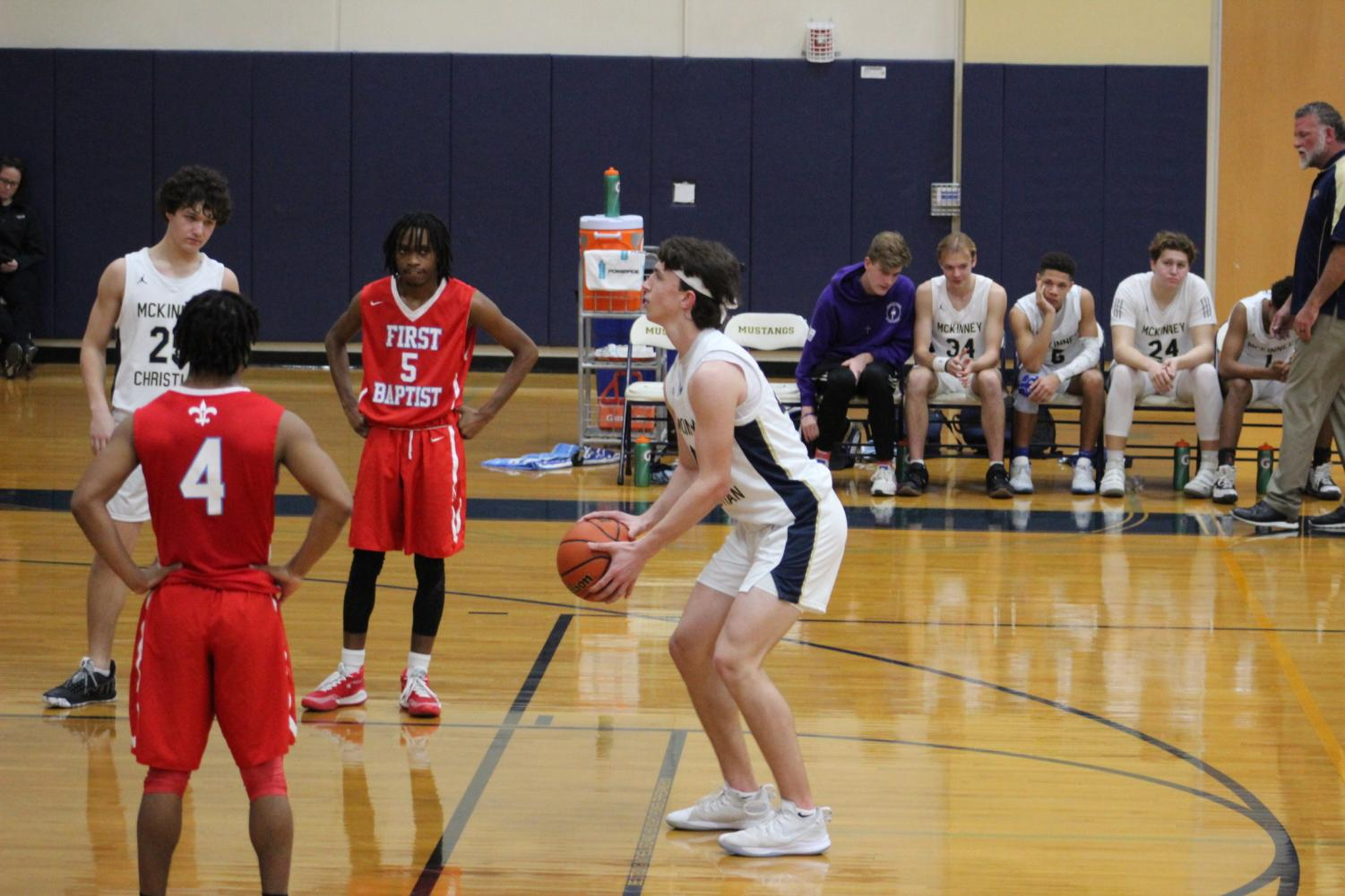 Junior Blake McGraw heads to the line to shoot two during the second half of the basketball game against First Baptist.