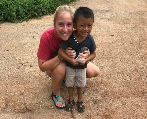 New teacher and coach Brandi Goforth poses for a picture with one of her missionary kids.