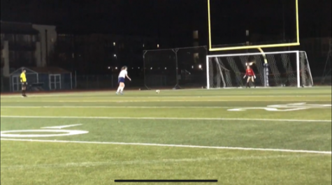 After a long fought game, Emma Bryant stares down the goalie as she attempts to score her PK.