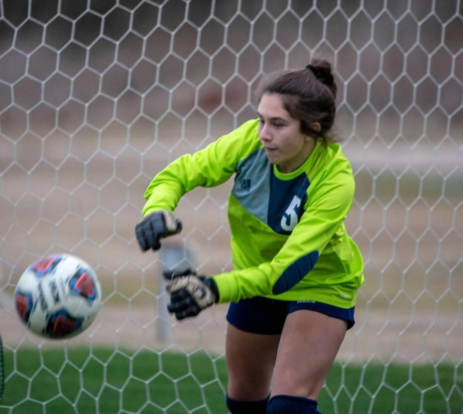 Freshman goalie Alexa Harriman blocks a ball during PK's.