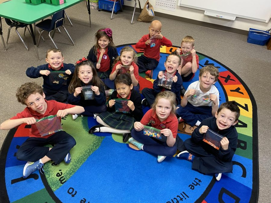Kindergarteners show off their 100 day collections that they brought.