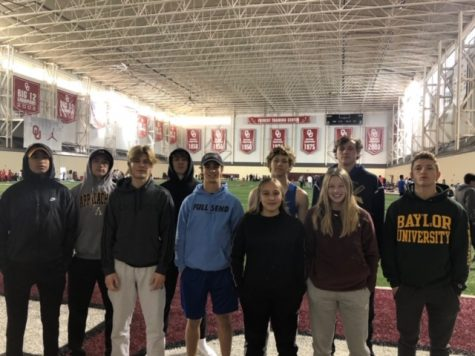 The MCA Indoor Track  Team takes another memorable photo upon arrival to OU.
