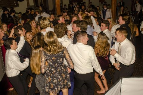 The senior class enjoys one last dance together at their last Winter Formal by dancing to