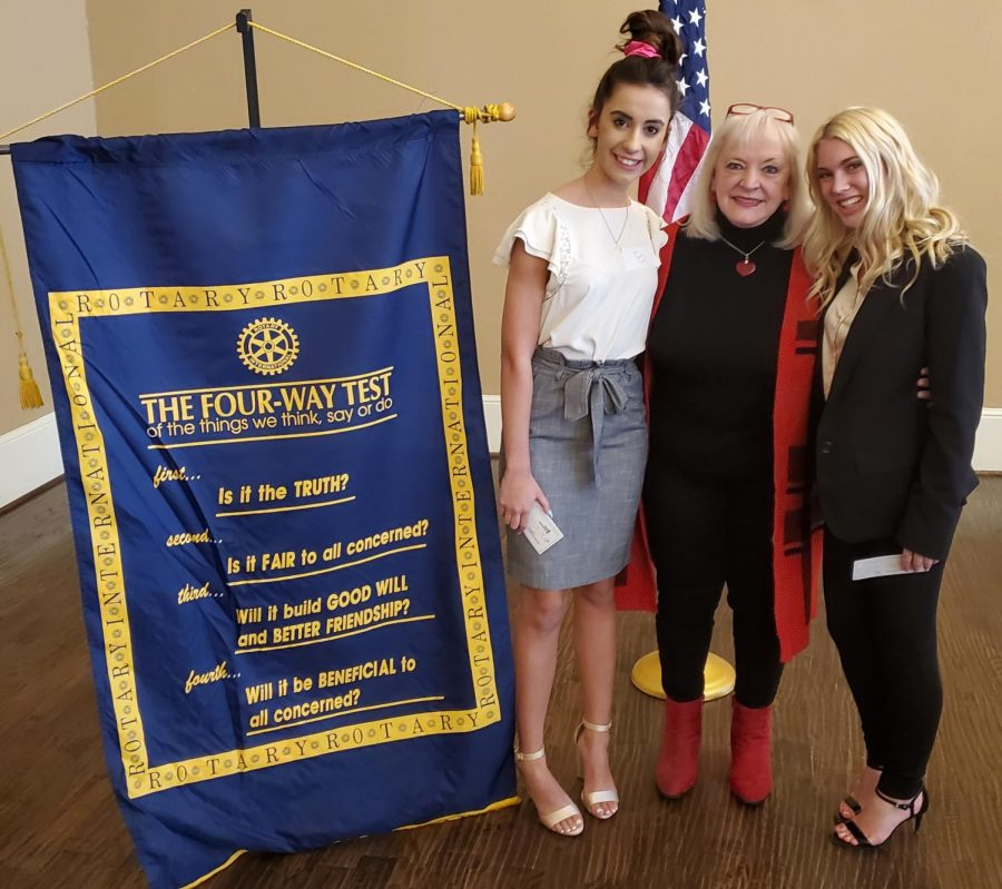 Seniors Sydney Wible and Meg Boone pose for a picture with Dr. Jane DeBord at the rotary club.