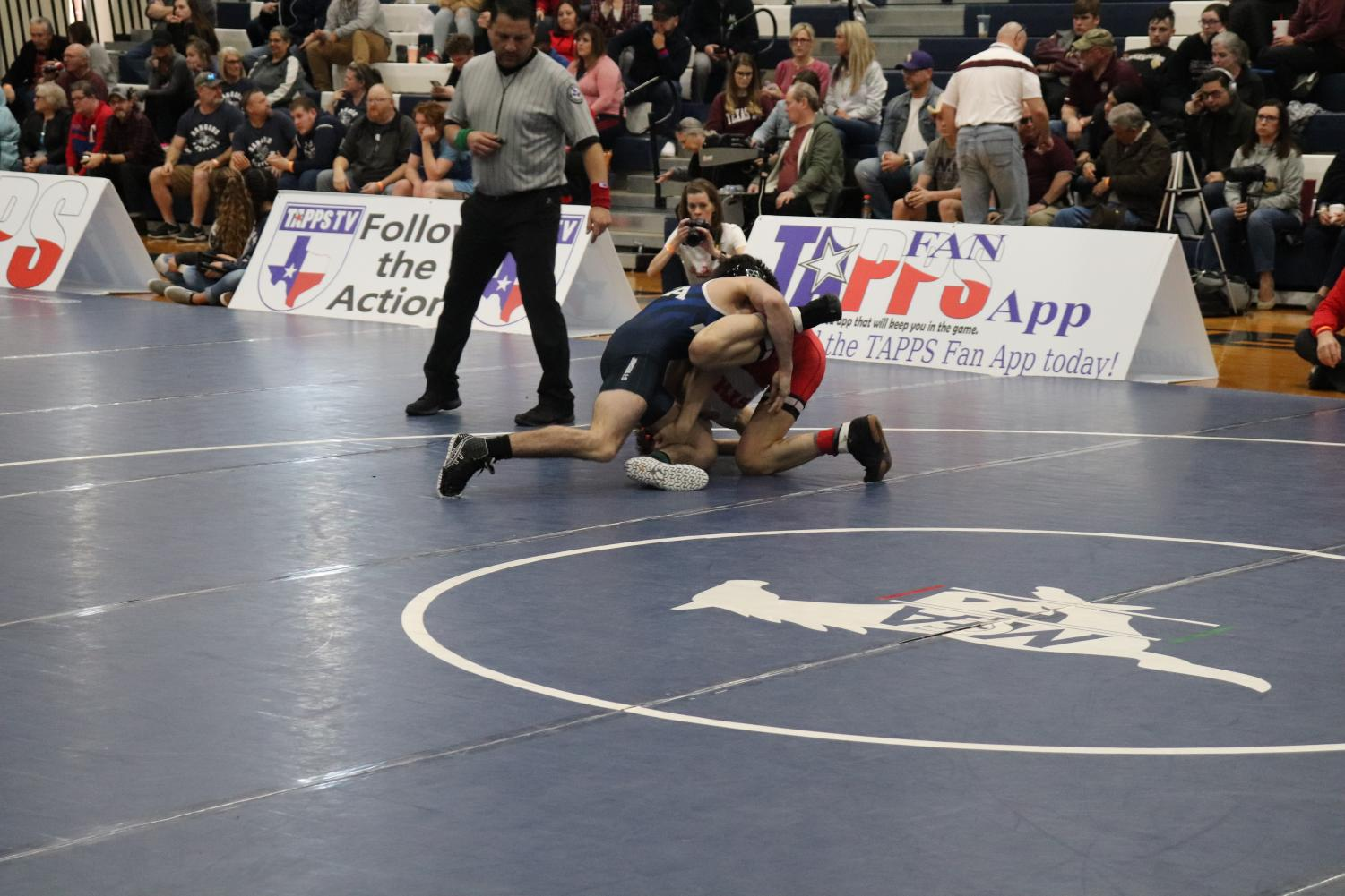 Sophomore+Conrad+Souther+rolling+his+opponent+on+his+back+in+the+attempt+to+pin+for+the+automatic+win.+