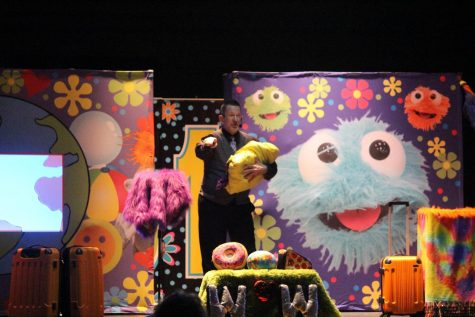 Denise Lee puts on his show with one of his puppets.