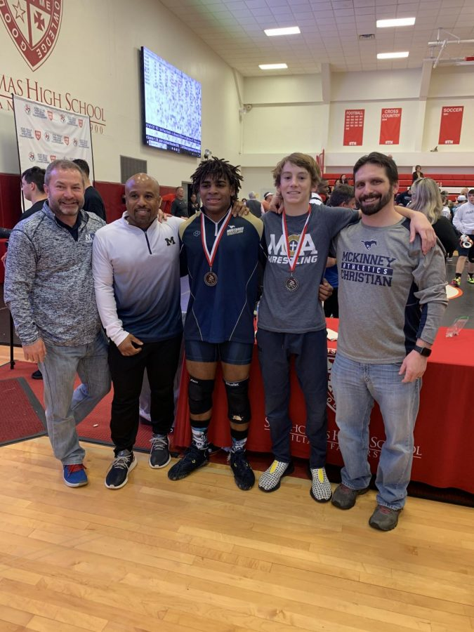 National qualifiers Nate Gwynn and Denzel Poulter posing for a picture with their coaches.