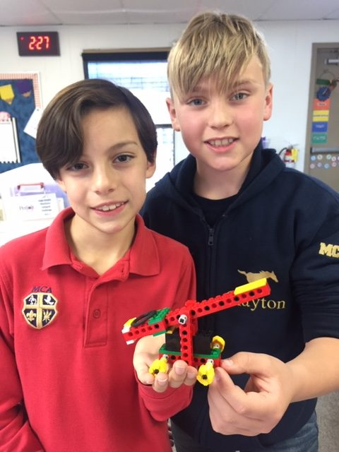 Fourth graders, Dusty Thibodeaux and Wheeler Clayton with their lego catapult