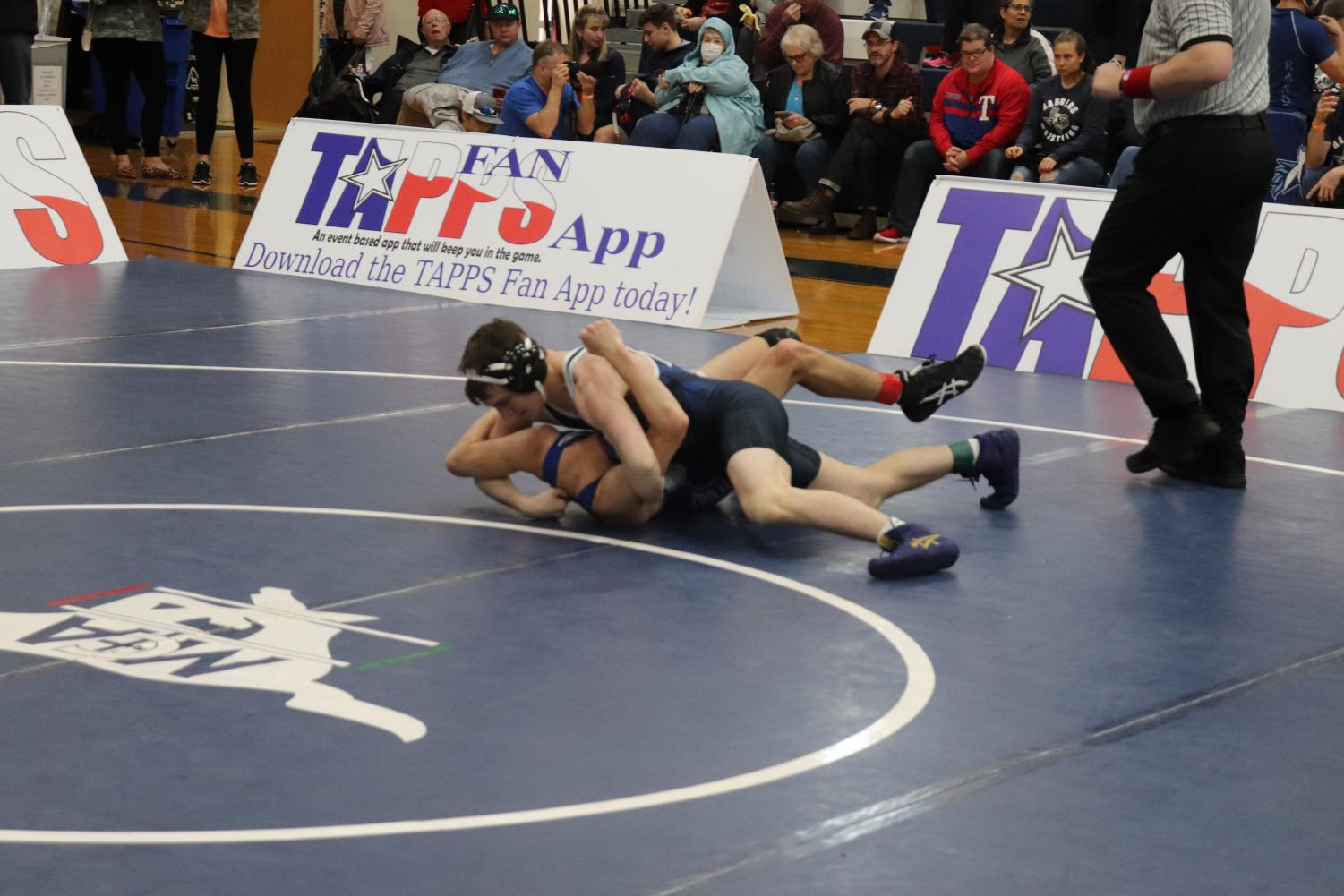 Junior+Patriot+Butler+attempting+to+pin+his+opponent+to+secure+the+win+of+this+match.+