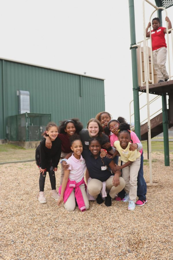 Senior Emma Bryant gets together with a group of kids during an afternoon of playtime.