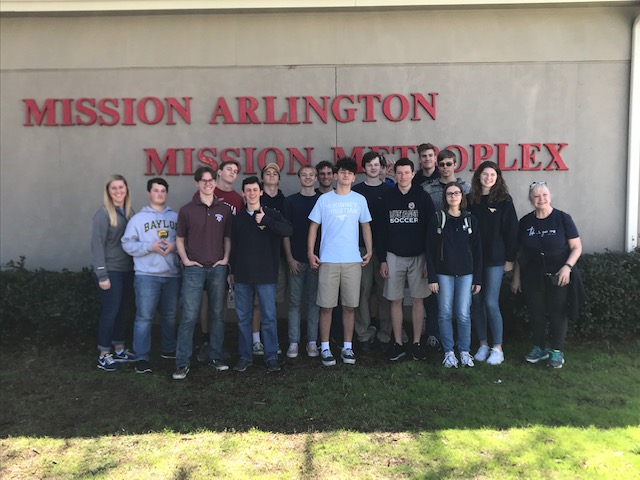 The group gathers for a picture outside of Mission Arlington before heading home on Thursday.