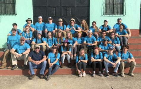 The mission team posed for a picture in front of the church they were working at.