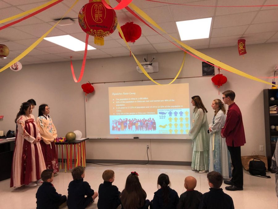 The freshmen present their country, China, to a group of Lower School students.