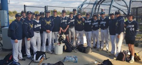 After a long fought game, the baseball team poses for a picture after an away game.