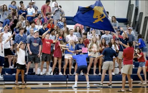 Upper School students cheer on their Lady Mustangs at the volleyball teams home opener versus Lucas Christian.