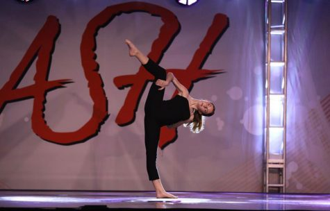 Brooke Jensen competing with a solo dance at competition.