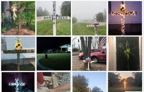 People are placing wooden crosses in their front yard to express 'Faith Not Fear.'