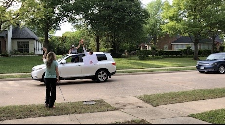 Mrs. Kuykendall waving at her students at her birthday parade.