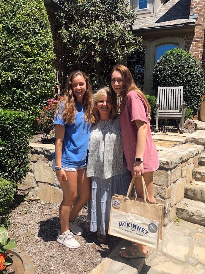 Upper School Government, AP Government, and U.S. History teacher, Laurie Hubert, delivered a cap and gown to senior Meredith Pogue.