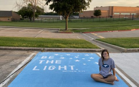 Senior Maggie George poses with her parking spot