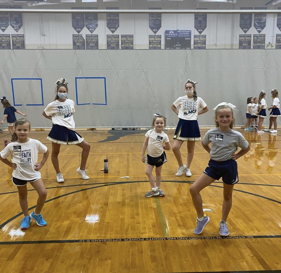 Middle School Cheerleaders with Kindergarten and 1st graders at the clinic