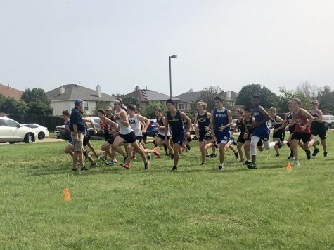 Boys cross country team starts relay