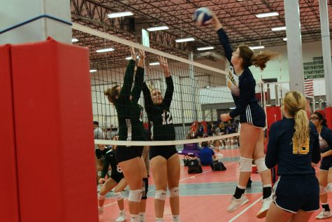Senior Ava Grace Haggard goes up for the kill.