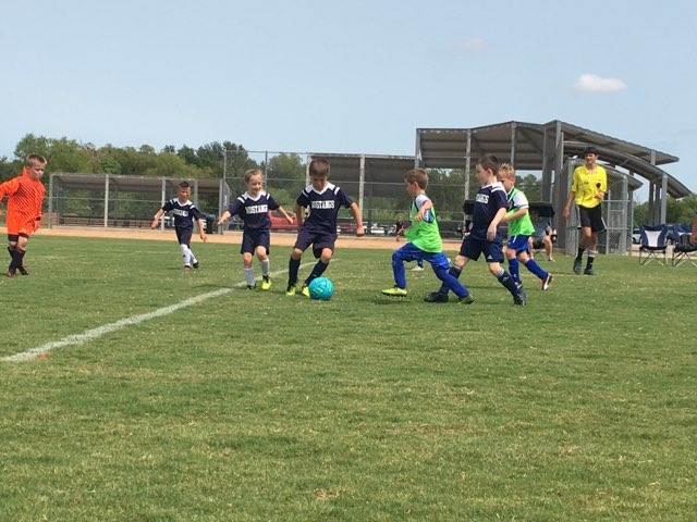 Members of the second grade team- Austin Lee, Anna Wall, Elijah Brudwick and Jaxon Hodges- head for the goal.