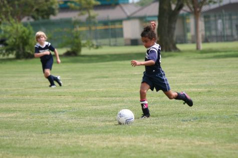 First grader Judah Lewis takes a big step preparing to kick the ball.
