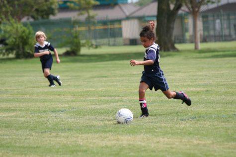 First grader Judah Lewis takes a big step preparing to kick the ball.