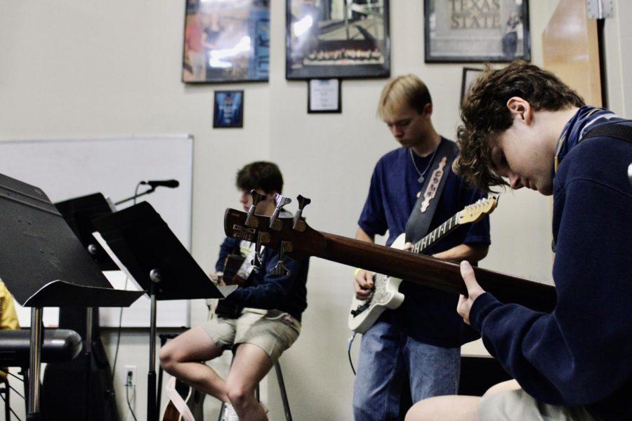 Junior+guitarist%2C+Marshall+Stubbs%2C+rehearsing+for+chapel+with+senior+Cole+Wilkinson+and+junior+Trevor+Clark.