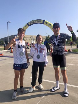 Alessia Catullo, Nick Catullo and Rhett McKeller smile, displaying their first place medals.