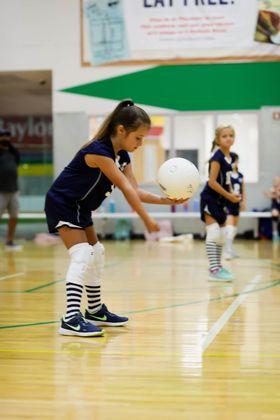 Second grader Ariel Kergosien gets ready to serve the ball.
