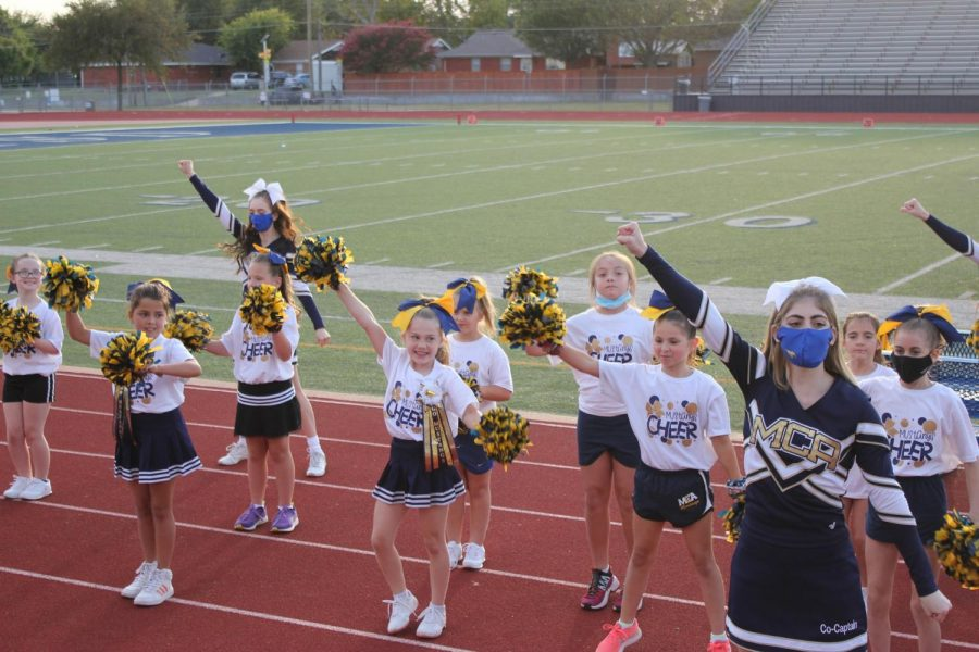Lil Stangs cheer performs during the second quarter at the homecoming football game.