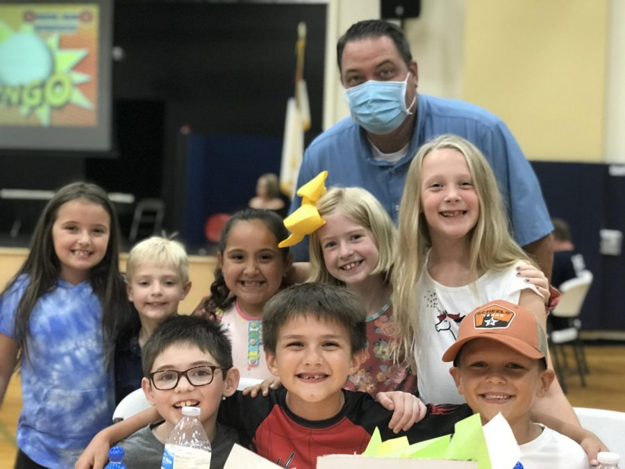 Lower School Principal Mr. Hydock takes a break to take a picture with lower school students at bingo night.