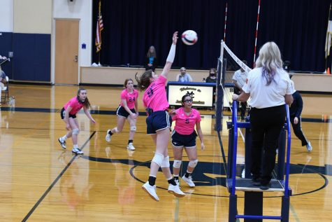 Senior Ava Grace Haggard going in for the kill against Brighter Horizons.