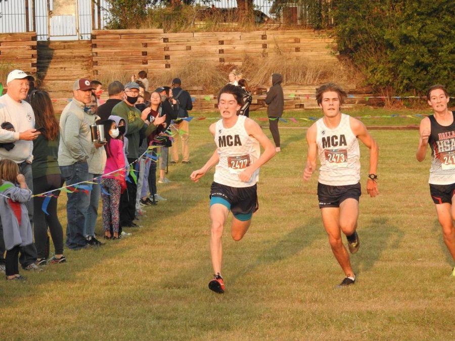 Freshman David Roller and junior Daniel Kanz battle to the finish line.