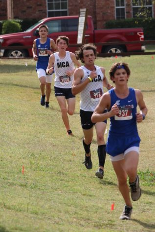 Varsity runners, senior Peter Michael Clark and freshman David Roller, fight for second and third place.
