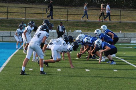 The Mustang defense tries to stop the Chargers on the goal line.
