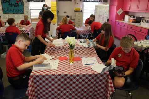 Fifth grade students observing different books during the book tasting.