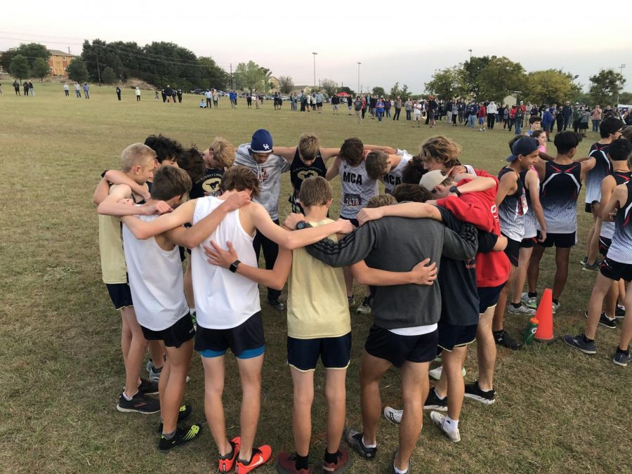 The Mustangs pray before the race.