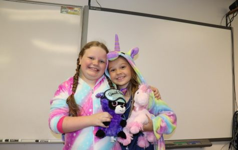 Fourth graders Maddie Anderson and Valesca Cormney pose for a photo on Pajama Day.