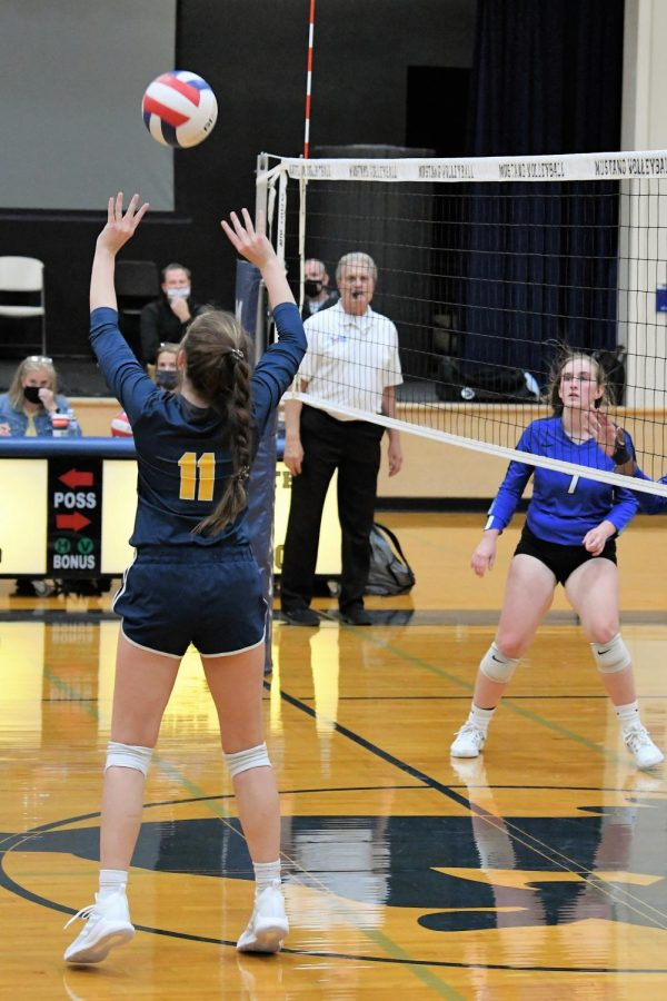 Juor Bella Vaught goes up to set the ball