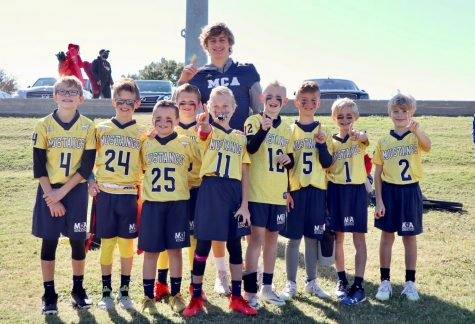 Fourth grade blue team poses for a picture after winning the championship game.