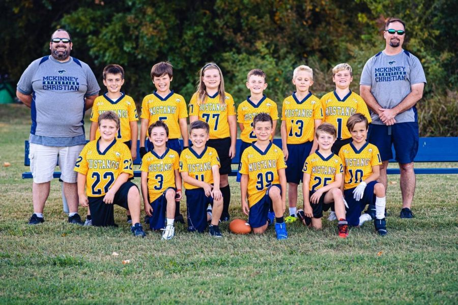 Third grade lil stands football team posing for a picture.