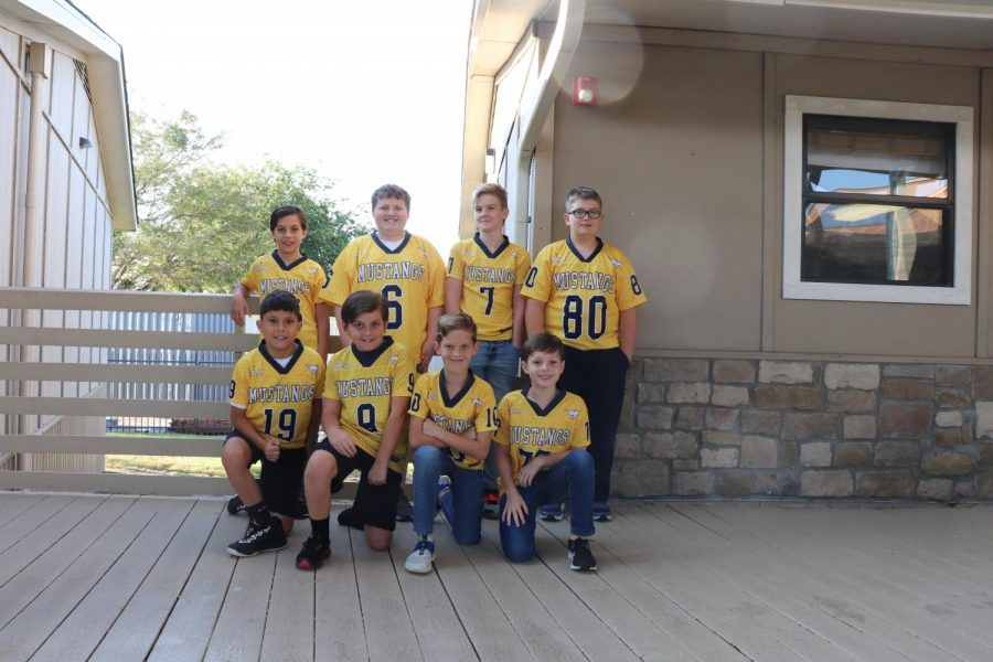 Fifth grade lil stangs football posing for a picture.