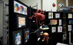 MCA's art class showcases art works like a paper mache and paintings.