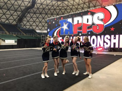 The Varsity Cheerleaders with their medals after placing second.