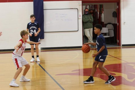 Eighth grader, Aaron Grant dribbles the ball up the floor.