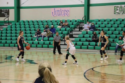 Junior Maddie Clark dribbles the ball up the court for the Lady Mustangs.